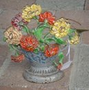 PAINTED CAST IRON  BASKET OF FLOWERS DOORSTOP