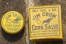 JIM CROW CORN SALVE TIN/BOX-CROW  AND FOOT IMAGE