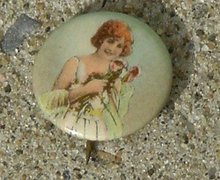 CELLULOID PINBACK BUTTON -PRETTY LADY IN WHITE