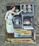 CURTIS BAKERY  SEWING KIT-WOMAN AND STOVE IMAGE