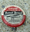 BOND BREAD LINDBERGH'S SPIRIT OF ST. LOUIS ADVERTISING CELLULOID PINBACK-PLANE IMAGE