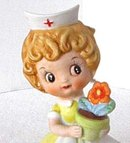 Josef Originals Red Cross Nurse With Flower