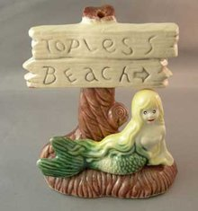 Older Aquarium Ornament Mermaid and Topless Beach Sign