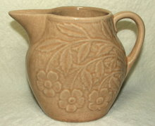 Old Brush McCoy Flower Embossed Tan Pitcher