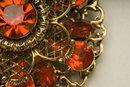 Vintage Hyacinth Glass Rhinestone and Goldtone Filigree Brooch