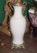 BRASS MOUNTED PORCELAIN URN IN CLASSICAL FORM
