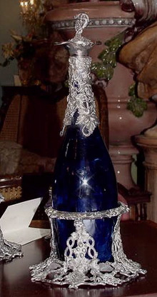 PAIR OF COBALT GLASS AND SILVER MOUNTED WINE DECANTERS