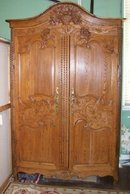 French Provincial Carved Pine Armoire