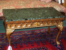 CONTINENTAL CARVED WALNUT AND MARBLE TOP COFFEE TABLE