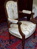 PAIR LOUIS XVI STYLE CARVED WALNUT ARMCHAIRS