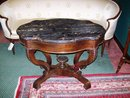 VICTORIAN CARVED WALNUT AND MARBLE TURTLETOP CENTER TABLE