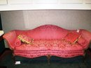 VENETIAN STYLE CARVED FRUITWOOD AND UPHOLSTERED SOFA