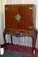 CHIPPENDALE STYLE WALNUT LIQUOR CABINET