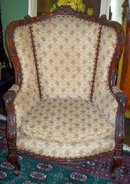 CONTINENTAL CARVED FRUITWOOD WING CHAIR