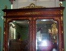 LOUIS XVI STYLE MAHOGANY AND ORMOLU MOUNTED ARMOIRE