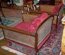 PAIR EDWARDIAN CARVED WALNUT AND CANE BERGERES