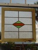 Green and Dark Orange Diamond Antique Stained Glass Window