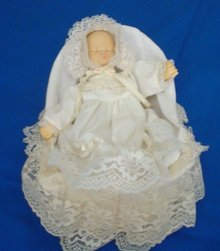 Sleeping Doll In Bassinet
