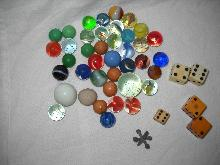 Vintage marbles and dice, one jack