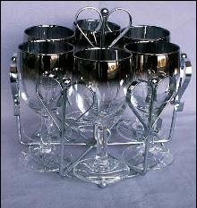 Six Stemmed Wine Glasses in Chromed Carrier