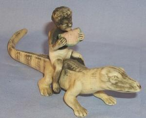 Black Boy Eating Watermelon Sitting On Alligator Porcelain Figurine - Ethnographic