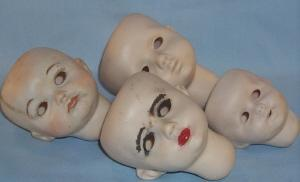 Four Bisque Porcelain Baby Doll Heads