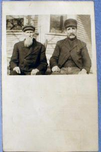 RPPC  Real Photo Postcard - Two Unidentified Men Seated - misc paper