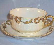 Signed LIMOGES Gold Trimmed Porcelain Cup and Saucer