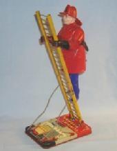 Marx CLIMBING FIREMAN Wind Up Tin Toy
