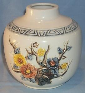 Raised Flower Decorated White Pottery Vase