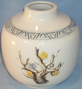 Raised Flower Decorated White Pottery Vase