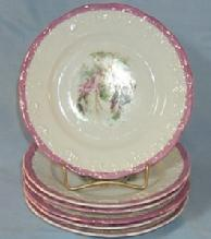 Six Small Unmarked Decorated Porcelain Plates