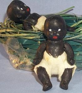 Ethnographic Two Bisque Black Babies in a Green Weaved Basket - Dolls