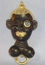 Ethnographic Black Worman's Head with Winking Eye Bottle Opener - Metalware