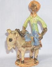Ethnographic CARIBBEAN NATIVE ON A DONKEY Glazed Pottery Figurine