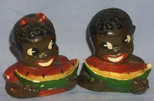 Ethnographic Chalkware Black Boy and Girl Eating Watermelon Salt and Pepper Set.