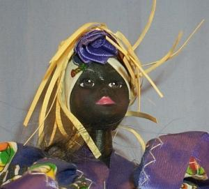 Ethnographic Doll In Purple Dress .
