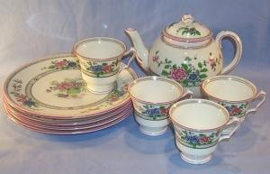 English Porcelain Flower Decorated TeaSet With Tea Pot  And  Four Luncheon Plates And Four Cups.
