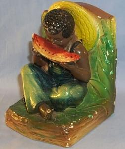 One Ethnographic Chalkware BookEnd BOY EATING WATERMELON