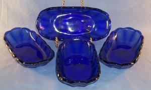 (4) Cobalt Blue Glass Banana Boat.