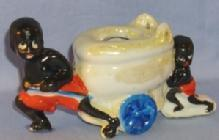 Black Memorabilia, Two Black Boys Pulling & Pushing A Toilet On Wheels Porcelain Figurine.