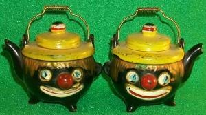Salt & Pepper Shakers Shaped Like A Tea Pot With Clown Faces.