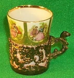 Small Porcelain Decorated Victorian Cup In Metal Holder