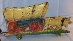 Cast Iron Oxen Pulled Coverd Wagon. Electric Lamp.