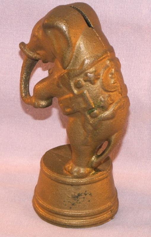Cast Iron ELEPHANT ON STAND Bank - Toys