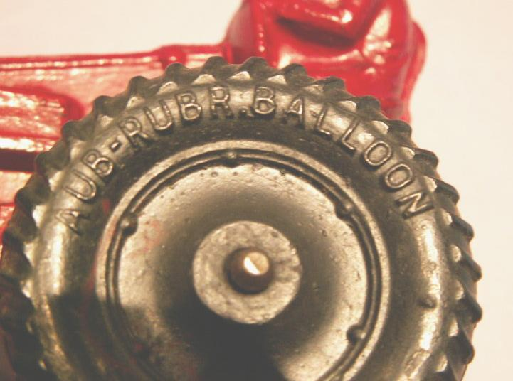 AUBURN Red Rubber Toy Farm Tractor.