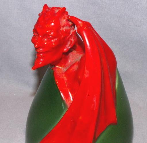 Porcelain Devil Figurine on Egg