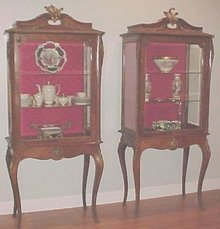 Rare - PAIR Hooded French Curio Cabinets Vitrines Cherubs and Garland Ormulu