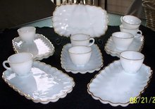 EIGHT GOLD RIMMED MILK GLASS SNACK TRAYS AND EIGHT CUPS