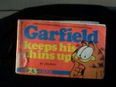 GARFIELD #23 KEEPS HIS CHINS UP BY JIM DAVIS